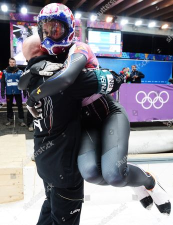 Noelle Pikus-pace (r) of the Usa Celebrates After Winning Silver the Women's Skeleton Competition at the Sanki Sliding Center at the Sochi 2014 Olympic Games Krasnaya Polyana Russia 14 February 2014 Russian Federation Krasnaya Polyana