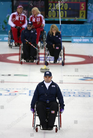 Patrick Mcdonald (front) of the Usa in Action During the Session 6 Round Robin Wheelchair Curling Match Usa Against Russia at the Sochi 2014 Paralympic Games Russia 10 March 2014 Russian Federation Sochi