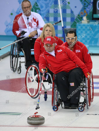 Patrick Mcdonald (f) of the Usa Delivers a Stone During Round Robin Session 5 Wheelchair Curling Match with Canada at the Sochi 2014 Paralympic Games in Sochi Russia 10 March 2014 Russian Federation Sochi
