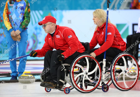 Patrick Mcdonald (l) and Penny Greely (r) of the Usa Deliver a Stone During Their Round Robin Wheelchair Curling Game Against China at the Sochi 2014 Paralympic Winter Games in Sochi Russia 12 March 2014 Russian Federation Sochi