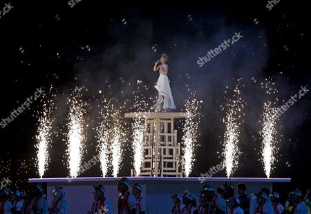 Singaporean Singer-songwriter Stefanie Sun Surrounded by Pyrotechnics Performs on a Platform During the National Day Parade in Singapore 09 August 2015 the Parade Features a Military Column an Aerial Flypast Titled 'Salute to the Nation' Dance Performances and Ends with a Firework Display Over the Marina Bay Singapore is Celebrating Its Golden Jubilee with a Yearlong National Campaign Titled 'Sg50' to Commemorate Its 50th Anniversary of Independence when the Island Nation Separated From the Federation of Malaysia on 09 August 1965 Singapore Singapore