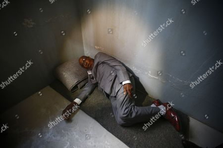 Andrew Mlangeni South African Political Activist and Former Political Prisoner Demonstrates How He Used to Sleep on the Floor in a Prison Cell During the Launch of the Replica of Nelson Mandela's Robben Island Prison Cell in Cape Town South Africa 26 September 2016 Former South African President and Nobel Peace Laureate Nelson Mandela was Imprisoned in a Cell of These Exact Proportions For 27 Years This Mobile Replica Will Make Its Way Around the Country to Enable Young People who Have Never Been to the Robben Island Museum to Get a Personal Perspective of the History That Unfolded on Robben Island and South Africa South Africa Cape Town