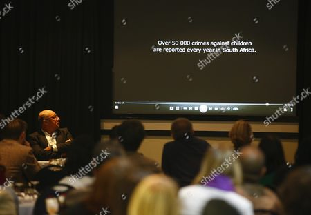 Former South African Finance Minister Trevor Manuel (l) Looks on at a Presentation Dealing with Child Abuse During a Breakfast Meeting in Celebration of the 2015 Year of Evaluation in Cape Town South Africa 18 September 2015 the Year 2015 is the International Year of Evaluation Or 'Evalyear' a Global Movement to Strengthen an Enabling Environment For Evaluation at Different Levels the Aim is to Strengthen the Demand For and Use of Evaluation to Inform Public Policies That Are Equity Focused and Gender Responsive the Meeting Brought Stakeholders From All Sectors Together For a Critical Engagement on How to Bring Evidence and Learning Into the Centre of Decision Making Evalyear 2015 was Launched in South Africa in March 2015 by Minister in the Presidency Jeff Radebe who Linked the Increased Use of Evidence in Government Decision Making to an Eradication of the Triple Challenges of Poverty Unemployment and Inequality the Meeting was Hosted by Southern Hemisphere a Socio-economic Development Consulting Company in Partnership with Monitoring and Evaluation Practitioners in the Western Cape (samea) and the Graduate School of Development Policy and Practice of the University of Cape Town South Africa Cape Town