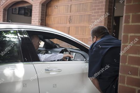 A Security Guard is Seen Talking to Arnold Pistorius Oscar's Uncle As He Leaves His House where Oscar Pistorius is Staying in Pretoria South Africa 21 October 2015 the South African Paralympic Athlete was Released Early on Parol While Serving a Five Year Sentence For Shooting Dead His Girlfriend Model Reeva Steenkamp the Correctional Services Released Pistorius Secretly the Night Before His Intended Release Date to Avoid Media Attention Pistorius was Acquitted of the Premeditated Murder of His Model Girlfriend Reeva Steenkamp in February 2013 But Found Guilty of Culpable Homicide (manslaughter) South Africa Pretoria
