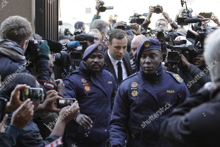 South African Paralympian Oscar Pistorius (c) Arrives at the North Gauteng High Court in Pretoria For His Sentencing For Murder Charges Pretoria South Africa 06 July 2016 the Supreme Court of South Africa Overturned the High Court's Verdict in December 2015 with South African Paralympian Oscar Pistorius Now Facing Sentencing For Murder of His Girlfriend Reeva Steenkamp on 14 February 2013 South Africa Pretoria