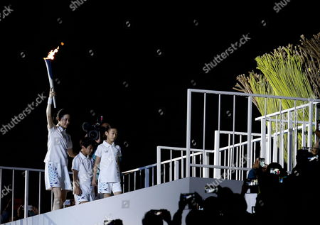 South Korean Actress Lee Young-ae (l) and Her Children Carry the Asian Games Torch Toward the Sacred Flame During the Opening Ceremony of the 17th Asian Games in Incheon South Korea 19 September 2014 the 2014 Incheon Asian Games Run From 19 September to 04 October 2014 Korea, Republic of Incheon