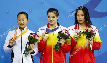 Stock Picture of (l-r) Silver Medalist Suzuki Satomi of Japan Goldmedalist Shi Jinglin of China and Bronze Medalist He Yun of China During Medal Ceremony the Women's 100 Meter Breaststroke Final at the 17th Incheon Asian Games at the Munhak Aquatics Center in Incheon South Korea 21 September 2014 the 2014 Incheon Asian Games That Run From 19 September to 04 October 2014 Korea, Republic of Incheon