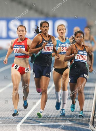 Silver Medalist Susmita Singha Roy of India (c) and Bronze Medalist Wang Qingling of China (l) Compete in Women's Heptathlon Event at the 17th Incheon Asian Games at the Asaid Main Stadium in Incheon South Korea 29 September 2014 Korea, Republic of Incheon