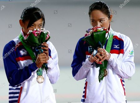 Bronze Medalists Mei Yu Hsiao (l) and Ting Ying Huang of Taiwan (r) Celebrate During the Medal Ceremony of the Women's Team Sprint Competition at the 17th Asian Games in Incheon South Korea 20 September 2014 Korea, Republic of Incheon