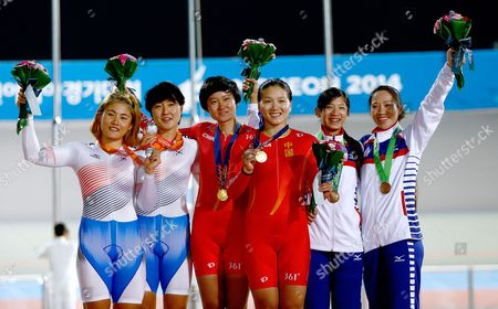 Gold Medalists Tianshi Zhong (c-l) and Jinjie Gong of China (c-r) Silver Medalists Wongyeong Kim (l) and Hyejin Lee of South Korea (2l) and Bronze Medalists Mei Yu Hsiao (2r) and Ting Ying Huang of Taiwan (r) Celebrate During the Medal Ceremony of the Women's Team Sprint Competition at the 17th Asian Games in Incheon South Korea 20 September 2014 Korea, Republic of Incheon