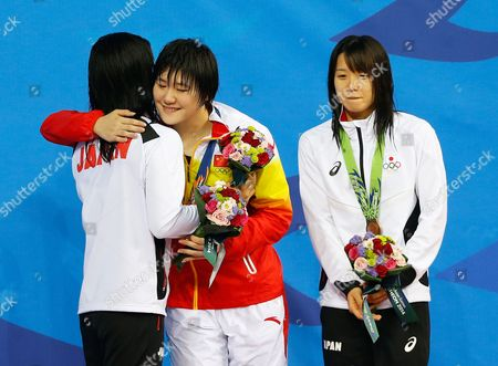 Ye Shiwen (c) of China Smiles on the Podium After Winning the Gold Medal in the Women's 200m Individual Medley Final During the Swimming Competitions at the 17th Incheon Asian Games at the Munhak Aquatics Center in Incheon South Korea 26 September 2014 Ye Shiwen Won Ahead of Silver Medalist Kanako Watanabe (l) and Bronze Medalist Miho Teramura (r) Both of Japan Korea, Republic of Incheon