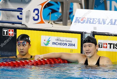 Ye Shiwen (r) of China Reacts Next to Second Placed Kanako Watanabe (l) of Japan After Winning the Gold Medal in the Women's 200m Individual Medley Final During the Swimming Competitions at the 17th Incheon Asian Games at the Munhak Aquatics Center in Incheon South Korea 26 September 2014 Korea, Republic of Incheon
