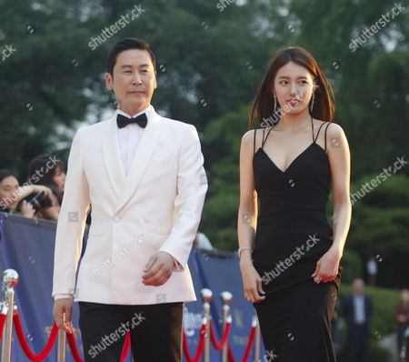 South Korean Gagman Shin Dong-yup(l) and South Korean Girl Group 'Miss A' Member Singer and Actress Suzy of Bea Soo-ji(r) Arrive For the 52th Annual Baeksang Art Awards at the Kyunghee University in Seoul South Korea 03 June 2016 Korea, Republic of Seoul