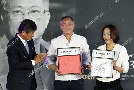 (l-r) Festival Director Lee Yong-kwan Hong Kong Director Johnnie to and Festival Director Kang Su-yeon Pose After Johnnie To's Handprinting Ceremony During the 20th Busan International Film Festival (biff) in the Southeastern Port City of Busan South Korea 02 October 2015 the Biff Runs From 01 to 10 October 2015 with 304 Titles From 75 Countries to Be Screened Korea, Republic of Busan