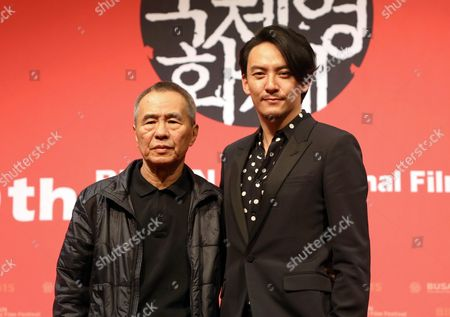 Taiwanese Director Hou Hsiao-hsien (l) and Taiwanese Actor Chang Chen (r) Pose For Photographers After the Press Conference For Their Movie 'The Assassin' (nie Yin Niang) During the 20th Busan International Film Festival (biff) in the Southeastern Port City of Busan South Korea 02 October 2015 the Biff Runs From 01 to 10 October 2015 with 304 Titles From 75 Countries to Be Screened Korea, Republic of Busan