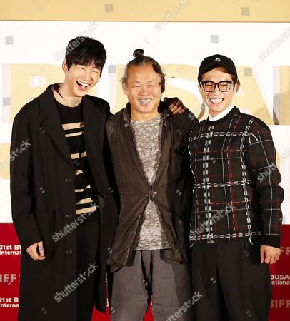 Stock Photo of (l-r) South Korean Actors Lee Won-geun Kim Young-min and South Korean Director Kim Ki-duk Pose For Photographers After the Outdoor Greeting For the Their Movie 'The Net' During the 21st Busan International Film Festival (biff) Plaza in Busan South Korea 09 October 2016 the Biff Runs From 06 to 15 October 2016 and Will Feature Sreenings of 301 Titles From 69 Countries Korea, Republic of Busan