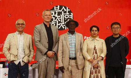 Stock Image of (l-r) Iranian Cinematographer-director Mahmoud Kalari Director of the International Film Festival Rotterdam Bero Beyer Malian Director and Head Juror Souleymane Cisse Indian Producer Guneet Monga and Chinese-south Korean Director Zhang Lu Pose For Photographers During the 21th Busan International Film Festival (biff) New Currents Section Jury at the Dongseo University Campus in Busan South Korea 07 October 2016 the Biff Runs From 06 to 15 October 2016 and Will Feature Sreenings of 301 Titles From 69 Countries Korea, Republic of Busan