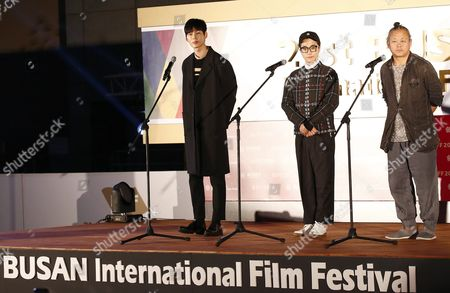 Stock Image of (l-r) South Korean Actors Lee Won-geun Kim Young-min and South Korean Director Kim Ki-duk Attend the Outdoor Greeting For the Their Movie 'The Net' During the 21st Busan International Film Festival (biff) Plaza in Busan South Korea 09 October 2016 the Biff Runs From 06 to 15 October 2016 and Will Feature Sreenings of 301 Titles From 69 Countries Korea, Republic of Busan