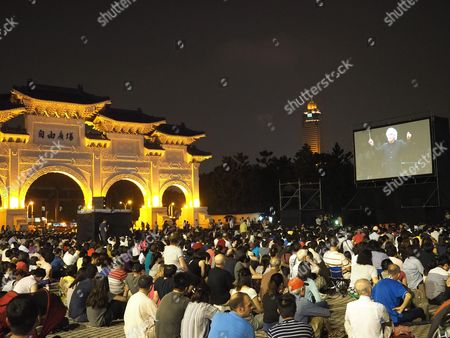 Taiwan Residents and Visitors Watch a Concert by British Sir Simon Rattle Chief Conductor of the Berlin Philharmonic Orchestra Displayed at an Outdoor Screen Outside the National Concert Hall at Liberty Square in Taipei Taiwan 07 May 2016 the Berlin Philharmonics Perform at the National Concert Hall on 07 and 08 May After Taipei They Will Fly to Tokyo Taiwan Taipei