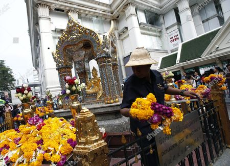Erawan Shrine Workers Remove Garland of Worships to a Statue of Lord Brahma the Hindu God of Creation at the Erawan Shrine in Bangkok Thailand 22 September 2015 Tourism Authority of Thailand (tat) Invitation Hong Kong Superstars Michelle Yim Also Known As Mai Suet and Simon Yam Tak-wah Visited the Erawan Shrine on 22 September to Help Restore the Confidence of Chinese Tourists Hong Kong and Thai Tourism Industry After a Bombing on 17 August That Killed at Least 20 People and Injured More Than Hundred Thailand Bangkok