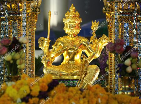 The Statue of Lord Brahma the Hindu God of Creation at the Erawan Shrine in Bangkok Thailand 22 September 2015 Tourism Authority of Thailand (tat) Invitation Hong Kong Superstars Michelle Yim Also Known As Mai Suet and Simon Yam Tak-wah Visited the Erawan Shrine on 22 September to Help Restore the Confidence of Chinese Tourists Hong Kong and Thai Tourism Industry After a Bombing on 17 August That Killed at Least 20 People and Injured More Than Hundred Thailand Bangkok