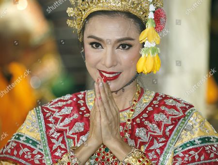 Hong Kong Superstar Simon Yam Tak-wah Dressed in Traditional Costume Greets in Thai Traditional Way After a Worship to a Statue of Lord Brahma the Hindu God of Creation at the Erawan Shrine in Bangkok Thailand 22 September 2015 Hong Kong Superstars Michelle Yim Also Known As Mai Suet and Simon Yam Tak-wah Are Visiting the Erawan Shrine on 22 September by Invitation of the Tourism Authority of Thailand (tat) to Help Restoring the Confidence of Tourists After a Bombing on 17 August That Killed at Least 20 People and Injured More Than Hundred Thailand Bangkok