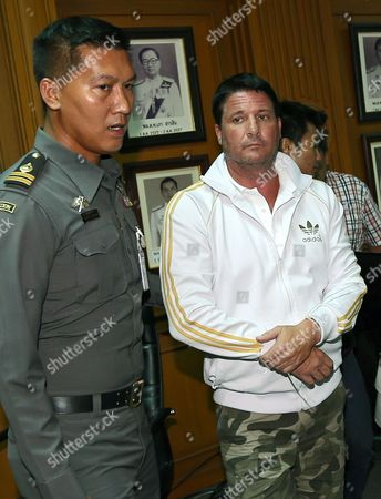 Stock Photo of Alleged Fraud Suspect Us National Theodore Andrew Werner 48 (r) ) is Escorted by Police Officers After a Press Conference at Central Investigation Bureau in Bangkok Thailand 20 July 2015 Thai Police Arrested a Suspected Us Man on Suspicion of Criminal Acts of Internet Fraud Worth Two Million Us Dollars (about 70 Million Thai Baht Or 1 84 Million Euro) As Wanted Under Us Law Enforcement by New York of United State on 18 July 2018 at Phuket Island Southern Thailand the Police Said Thailand Bangkok