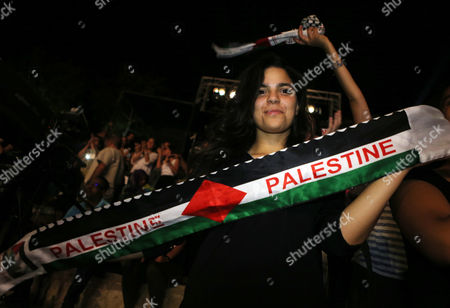 A Woman Holds a Palestinain Flag During the Concert of Palestinian Singer Mohammed Assaf who Won ' Arab Idol 2013 ' During the 51th International Festival of Carthage at the Roman Theatre of Carthage in Tunis Tunisia Late 26 July 2015 Tunisia Tunis