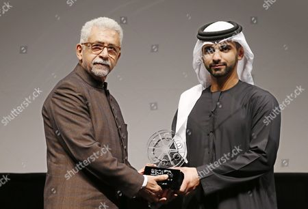 Indian Film and Stage Actor and Director Naseeruddin Shah (l) Receives From Sheikh Mansour Bin Mohammed Bin Rashid Al Maktoum(r) a Lifetime Achievement Award During the Opening Ceremony of the 12th Dubai International Film Festival (diff) 2015 in Gulf Emirate of Dubai United Arab Emirates 09 December 2015 the Diff Runs From 09 Until 16 December United Arab Emirates Dubai