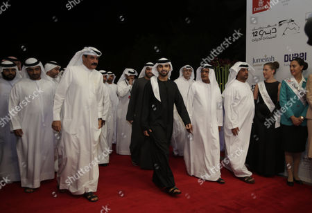 Sheikh Mansour Bin Mohammed Bin Rashid Al Maktoum(c) with Dubai Police Chief Major General Khamis Al Muzaina(l) Arrive at the Opening Ceremony of the 12th Dubai International Film Festival (diff) 2015 in Gulf Emirate of Dubai United Arab Emirates 09 December 2015 the Diff Runs From 09 Until 16 December United Arab Emirates Dubai