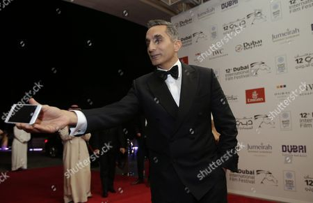 Egypt's Political Satirist Bassem Youssef Arrives at the Opening Ceremony of the 12th Dubai International Film Festival (diff) 2015 in Gulf Emirate of Dubai United Arab Emirates 09 December 2015 the Diff Runs From 09 Until 16 December United Arab Emirates Dubai