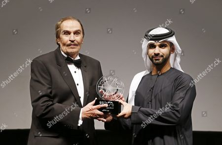 Egyptian Actor Ezzat El-alayli (l) Receives From Sheikh Mansour Bin Mohammed Bin Rashid Al Maktoum (r) a Lifetime Achievement Award During the Opening Ceremony of the 12th Dubai International Film Festival (diff) 2015 in Gulf Emirate of Dubai United Arab Emirates 09 December 2015 the Diff Runs From 09 Until 16 December United Arab Emirates Dubai