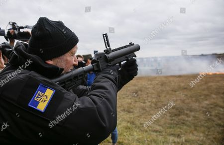 Ukrainian Secretary to the National Security and Defence Council Oleksandr Turchynov Tests a Grenade Launcher During a Demonstration of Weapon Models Which Are Intended For Special Units of the National Police on a Shooting Range in the Village of Novi Petrivtsi Near Kiev Ukraine 13 November 2015 the Organization For Security and Cooperation in Europe (osce) Which Has Been Independently Monitoring the Conflict in Eastern Ukraine For the Past Year and a Half Said on 11 November That It Had Observed More Than 90 Explosions and Bursts of Small Arms Fire Near the Rebel Stronghold City of Donetsk the Osce Did not Attribute Blame For the Escalation in the Violence the Ukrainian Military and the Rebels Were Supposed to Have Withdrawn Small Arms From the Front Lines According to a Deal Reached by the Presidents of Ukraine and Russia Last Month the Ukrainian Government and Rebel Forces Had Earlier Agreed to Withdraw Heavier Weapons Ukraine Kiev