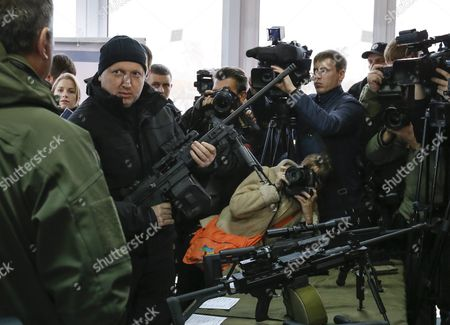 Ukrainian Secretary to the National Security and Defence Council Oleksandr Turchynov (2-l) Inspects Weapons During a Demonstration of Models of Weapons Which Are Intended For Special Units of the National Police on a Shooting Range in the Village of Novi Petrivtsi Near Kiev Ukraine 13 November 2015 the Organization For Security and Cooperation in Europe (osce) Which Has Been Independently Monitoring the Conflict in Eastern Ukraine For the Past Year and a Half Said on 11 November That It Had Observed More Than 90 Explosions and Bursts of Small Arms Fire Near the Rebel Stronghold City of Donetsk the Osce Did not Attribute Blame For the Escalation in the Violence the Ukrainian Military and the Rebels Were Supposed to Have Withdrawn Small Arms From the Front Lines According to a Deal Reached by the Presidents of Ukraine and Russia Last Month the Ukrainian Government and Rebel Forces Had Earlier Agreed to Withdraw Heavier Weapons Ukraine Kiev