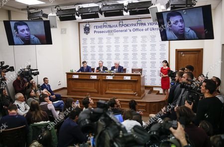 Stock Photo of Screens Show a Portrait of the Leader of the Ukrainian Party 'Ukrop' Former Deputy Governor of Dnipropetrovsk Gennadiy Korban As Vasiliy Hrytsak (c) the Head of the Security Service of Ukraine (sbu) and Prosecutor-general Viktor Shokin (c-r) Speak at a News Conference in Prosecutor Generals Office of Ukraine in Kiev Ukraine 02 November 2015 the Leader of the Ukrainian Party 'Ukrop' and Former Deputy Governor of Dnipropetrovsk Gennadiy Korban was Arrested in Dniptopetrovsk on 31 October 2015 on Suspicion of Organizing a Criminal Group According to the Prosecutor Generals Office of Ukraine Others Are not Identified Ukraine Kiev
