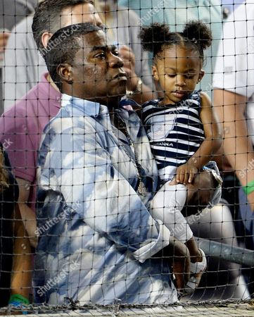 Us Comedian Tracy Morgan Holds His Daughter Maven Sonae During the Game Between the Boston Red Sox and the New York Yankees at Yankees Stadium in the Bronx New York Usa on 04 August 2015 Morgan was in a Serious Car Accident Last Summer United States Bronx