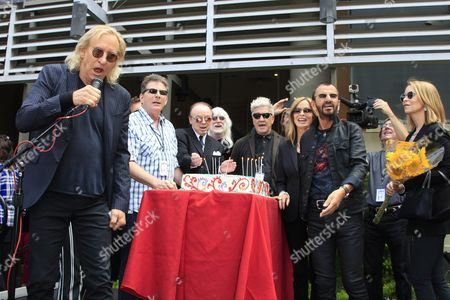 From Left: Musicians Joe Walsh Edgar Winter Us Director David Lynch Barbara Bach Uk Musician Ringo Starr Marjorie Bach and Ringo's Birthday Cake at a Celebration of His 75th Birthday at Capitol Records in Hollywood Los Angeles California Usa 07 July 2015 the Former Beatle Celebrated with a 'Peace & Love' Salute at Noon with Friends and Fans United States Los Angeles