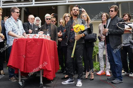 From Left: Guests Edgar Winter Us Director David Lynch Barbara Bach Uk Musician Ringo Starr Marjorie Bach Glenn Ballard and Ringo's Birthday Cake at a Celebration of His 75th Birthday at Capitol Records in Hollywood Los Angeles California Usa 7 July 2015 the Former Beatle Celebrated with a Peace & Love Salute at Noon with Friends and Fans United States Los Angeles