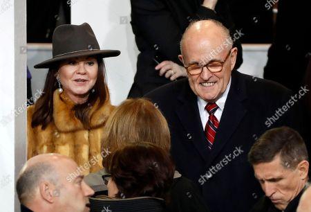 Rudy Giuliani, Judith Nathan Giuliani Former New York Mayor Rudy Giuliani, right, and his wife Judith talk during the 58th Presidential Inauguration parade for President Donald Trump in Washington