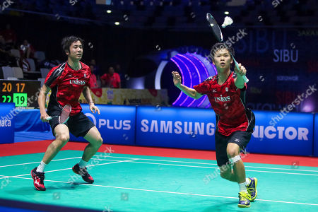 Stock Picture of Endo Hiroyuki, Watanabe Yuta Japan's Watanabe Yuta, right and Endo Hiroyuki, return a shot to Indonesia's Angriawan Berry and Hardianto during the Victor Far East Malaysia Masters men's doubles semi final match in Sibu, Sarawak, Malaysia on