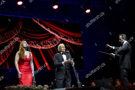 Stock Picture of Russian soprano Elena Stikhina, Spanish tenor Jose Carreras and Spanish conductor David Gimenez (L-R) perform during their concert in Papp Laszlo Sports Arena in Budapest, Hungary, 20 January 2017.