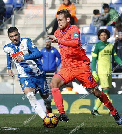Espanyol's midfielder Jose Antonio Reyes (L) vies for the ball with Granada's Icelandic defender Sverrir Ingi Ingason (R) during the Spanish Primera Division soccer match between Espanyol Barcelona and Granada at RCDE Stadium in Cornella-El Prat, Barcelona, northeastern Spain, 21 January 2017.