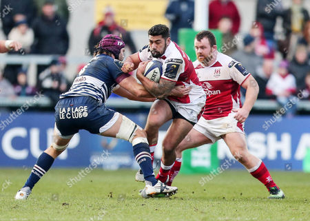 Stock Image of Ulster vs Bordeaux-Begles. Ulster?s Charles Piutau is tackled by Bordeaux-Begles? Tom Palmer