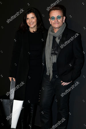 Singer Bono and his wife Ali Hewson pose during a photocall before Christian Dior's Men fall-winter 2017-2018 fashion collection presented in Paris