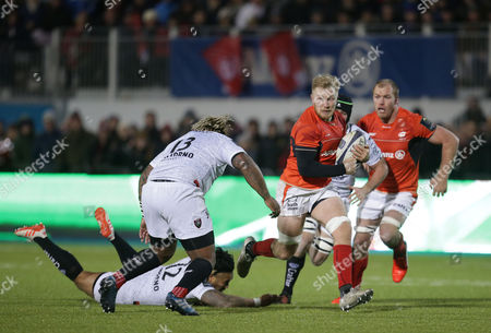 Jackson Wray of Saracens gets away from Ma?a Nonu but is about to be tackled by Mathieu Bastareaud (13) of Toulon