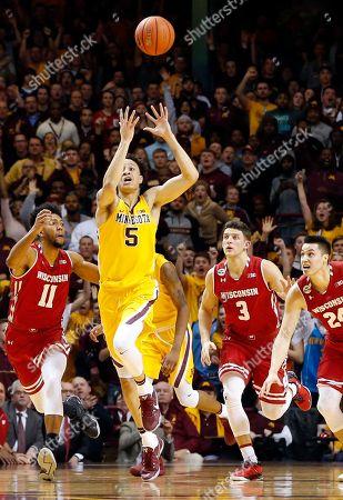 Amir Coffey, Jordan Hill, Zak Showalter, Bronson Koenig Minnesota's Amir Coffey (5) breaks away as Wisconsin's Jordan Hill (11), Zak Showalter (3) and Bronson Koenig pursue during the second half of an NCAA college basketball game, in Minneapolis
