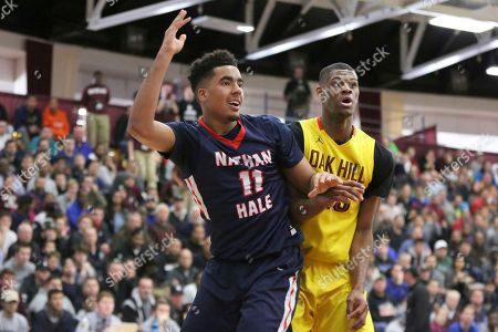 Oak Hill Academy's Billy Preston #23 in action against Nathan Hale's Jontay Porter #11 during a high school basketball game at the 2017 Hoophall Classic, in Springfield, MA