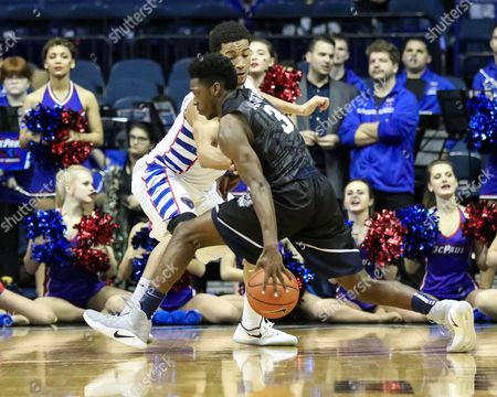 Saturday  - Butler Bulldogs guard Kamar Baldwin (3)makes a move to the basket while being defended by DePaul Blue Demons guard Billy Garrett Jr. (5) during NCAA Mens basketball game action between the Butler Bulldogs and the DePaul Blue Demons at the Allstate Arena in Rosemont, IL