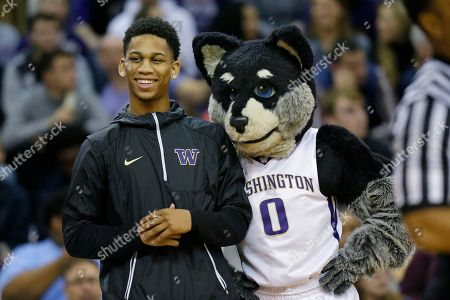 Stock Picture of Blake Harris, Harry Blake Harris, a senior high school point guard from the Word of God Christian Academy in Raleigh, North Carolina, is introduced next to Harry the Washington mascot during a timeout in an NCAA college basketball game between Washington and Utah, in Seattle. Harris has signed a letter of intent to play for Washington next year