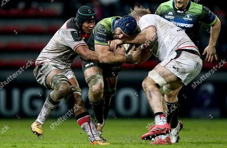 Toulouse vs Connacht. Connacht's John Muldoon is tackled by Gillian Galan and Thierry Dusautoir of Toulouse